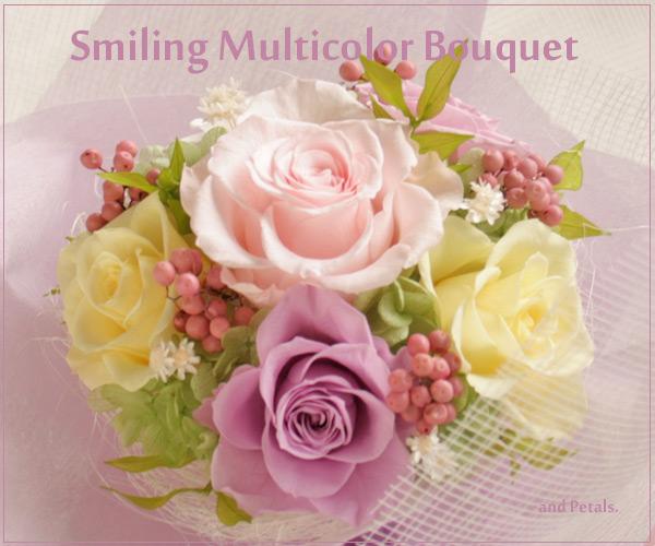 パステルカラーのバラがカラフルなプリザーブドフラワーの花束