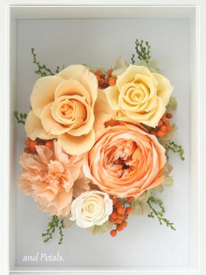 ジューシーオレンジの写真立て付きアレンジメント